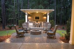 Woah! This outdoor living space is amazing! Love the fire pit, out door kitchen and plasma! I could see a lot of cookouts happening here! The Pawley model in Hilton Head, South Carolina.