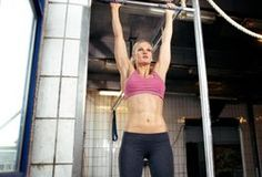 Pull-ups are body weight exercises that work multiple upper body muscles, such as the latissimus dorsi, pectorals and biceps. For a variation to your normal ab workouts, use a pull-up bar to work your lower rectus abdominis and obliques. The obliques are found on the sides of your stomach.