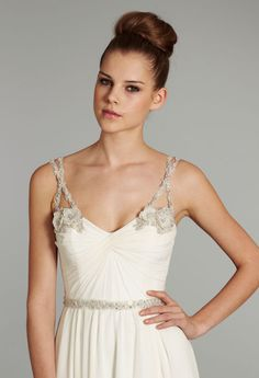 Ivory Silk georgette Grecian draped bridal gown with crystal floral beaded straps and crisscross tulle detailing at center back with chapel train. Available in Ivory and White.