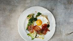 Escarole w/Crispy Ham & Eggs Like all good leafy greens, the giant pile of escarole leaves will wilt down dramatically as they cook. Avocado Recipes, Egg Recipes, Brunch Recipes, Cooking Recipes, New York Times Cooking, Charcuterie Recipes, Ham And Eggs, Incredible Edibles, Egg Dish