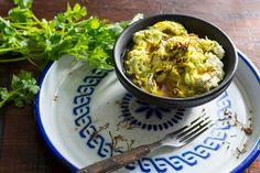 Nepali Cucumber pickle salad (kaakro ko achar) raw vegan style: cucumber noodles, ground sesame seeds, 1 young coconut meat, lemon juice, coriander leaves, mustard seeds, black pepper, Timur (ground sichuan pepper), jimbu, fenugreek seeds, turmeric