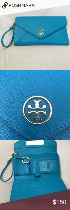 Tory Burch Robinson Envelope Wristlet A cutout logo medallion gleams against the crosshatch-textured leather that comprises a smart envelope wristlet.  Features a magnetic snap flap closure, interior zip, currency, and lipstick pockets, six card slots, an ID window, a pen loop, and a key ring.  Made of beautiful leather in a bright blue color.  Brand new, in perfect condition.  An amazing wallet and wristlet! Tory Burch Bags Clutches & Wristlets