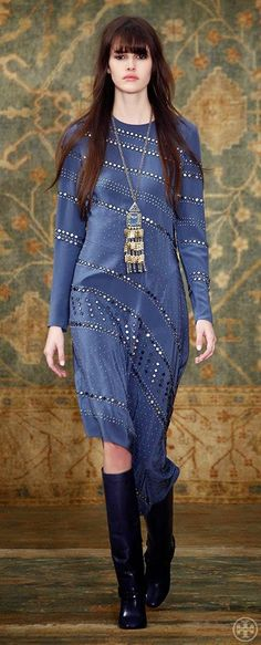 36c223c994 Blue dress with embelleshed stud detail worn with riding boots and a  statement necklace on the Tory Burch Fall 2015 runway