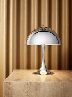 Verner Panton's Iconic Panthella MINI Shines Bright in Chrome