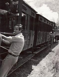 François Truffaut (hanging off a train) on the set of Les Deux Anglaises Et Le Continent (Two English Girls), 1971.  http://semioticas1.blogspot.com.br/2011/11/cahiers-du-cinema.html .