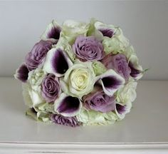 Vermeer calla lily bouquet with purple and cream roses