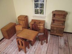 This doll house kitchen set is a mixture of mostly Nancy Forbes furniture and a few other pieces. All are made of light wood with glued construction