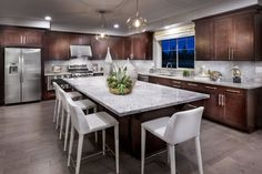 Would you be in CHARGE of this kitchen with an island this LARGE?!