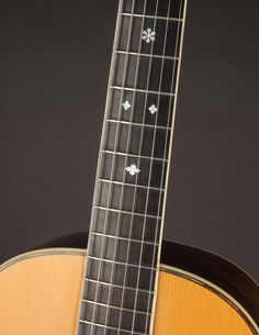 This Martin 00-30 from 1903 has a quality of tone that is purely sublime, combining the best aspects of steel and gut into one magical instrument. Martin Acoustic Guitar, Hard Pressed, Guitars, At Least, Instruments, Delicate, Steel, The Originals, Modern