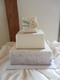 Simply elegant three tier wedding cake in silver, ivory and periwinkle (Brooklyn Girl Bakery - Phoenixville, PA)