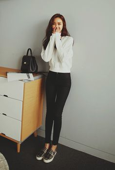 black high waisted jeans and white sweater