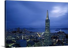 Buildings lit up at dusk, Transamerica Pyramid, Coit Tower, San Francisco, California,