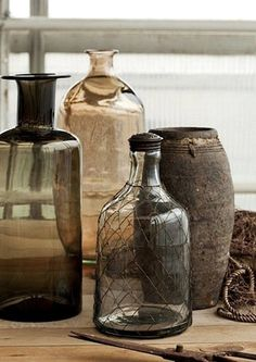 Grey glassware mixed with vintage bottles and vases for height and texture. Vintage Bottles, Bottles And Jars, Glass Bottles, Antique Bottles, Wabi Sabi, Vibeke Design, Bottle Vase, Bottle Stoppers, Fifty Shades Of Grey