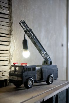 repurposed firetruck toy, turned into a lamp. Blue Velvet Chair: A Day's Worth of DIY Inspiration - Repurposed Boy Room, Kids Room, Child's Room, Fire Engine, Fire Trucks, Toy Trucks, Diy For Kids, Upcycle, Reuse Recycle
