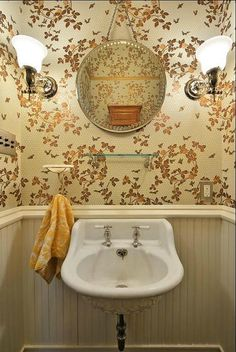 Painted Queen Anne Cottage in Austin TX - This remodeled bathroom with it's vintage sink, reproduction wall paper and old mirror is stunning!
