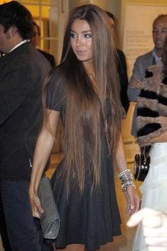 I wish my hair would HURRY UP and grow as long as hers. LOL