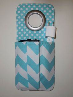 This cell phone charging socket holder is the perfect solution for charging your cell phone at home, in the dorm, & when traveling! Say goodbye to leaving your phone on dirty hotel room floors! And say hello to your favorite snowman! Now you can protect your iPhone from being stepped on by using this unique handmade cell phone charging station pocket. Click on the photo or go to www.etsy.com/shop/LisasBagstoRiches to order your cell phone pocket today!
