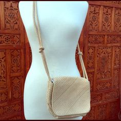 """VINTAGE DE VECCHI by Hamilton and Hodge -Xbody bag This Vintage beige Cord handbag made in Italy featuring beautifully woven straw and silk cording with a flap and snap closure.   The handbag is lined with black faille, and has two compartments with a brass label and the woven cord strap can be worn across the body or over the shoulder.  It's small but big enough to fit your wallet and phone, the dimensions are 9"""" wide by 6"""" tall by 3"""" across the bottom of the bag.  Great condition with…"""