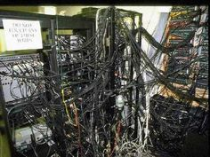 Poor data center cable management.  I'm expecting Shelob the spider from Lord of the Rings to emerge any moment.