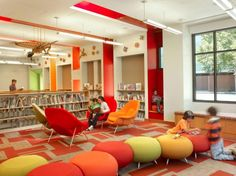 Children library design decorating ideas with playing spaces:children's library display ideas and seat furniture with orange theme decorating