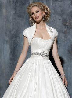 This Rachael gown by Maggie Sottero can come with a matching bolero (shown in ivory)