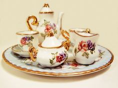 Hand painted 10 piece Mini Tea Set Dresden style with Roses and Scroll Trimmed in Gold