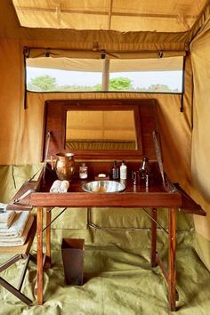 Legendary serengeti mobile camp - serengeti national park, t Camping Tent Decorations, Tent Camping, Camping Ideas, Camping Storage, Camping Hacks, Campaign Desk, Campaign Furniture, British Colonial Decor, Wall Tent