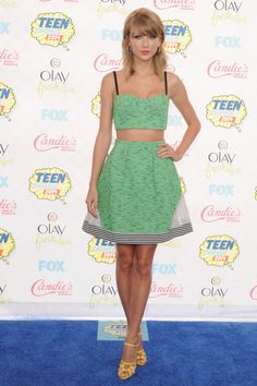 Taylor Swift's crop top and high-waist skirt combo never fails to look stunning.