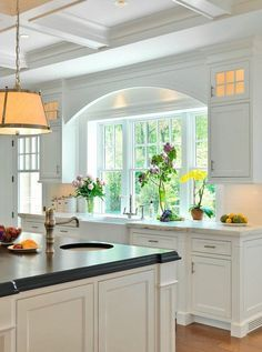 Arched detail over sink, coffered ceiling, Farmhouse Kitchen Sink - Counter Flush with Window - Jan Gleysteen Architects