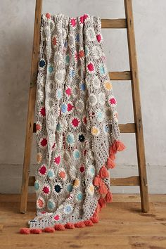 Amedee Crochet Throw. A cosy vintage-inspired throw with pretty pops of colour.