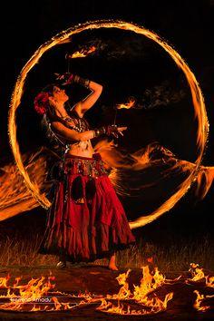 Ring of fire, belly dancer http://25.media.tumblr.com/c4c05ea1f54ee929ef8970a56548ec68/tumblr_mqejlqa7ki1r8g8d7o1_500.jpg