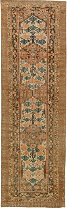 This circa-1920 antique Persian Hamadan runner rug features an all-over design of elaborate geometric abstractions