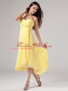 Simple Yellow Spaghetti Straps Prom Dress Beading and Ruch With Chiffon  http://www.fashionos.com  Show off your fun and flirty ! The figured-hugging bodice is accented with spaghetti straps and notched ruchings and the hidden zipper on the back. The ruched bodice is also embellished with a beading. It has a flowy skirt that will move freely when you walk around. You will draw many attention when you arrive at your party.  chiffon dress with zipper up back   prom dress with ruchings