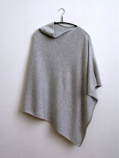 Silver Grey Scottish Spun Cashmere Poncho. Suttons knitwear is a family run business, we specialise in the highest quality Scottish Cashmere and Italian Cashmere & Silk yarns.