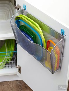 Utilize thrifty organizers to make over the chaotic space where you stash food-storage containers. A wall file mounted to a cabinet door is an easy solution for separating plastic lids from bases./