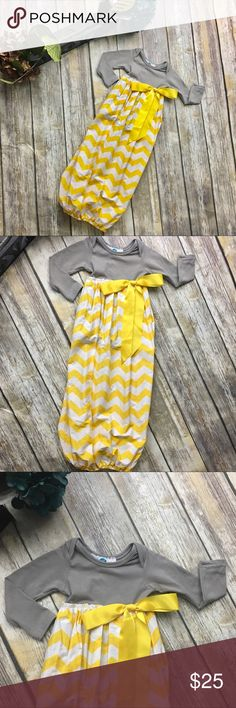 Boutique Chevron Print Gray And Yellow Gold Gown Omg! This little beauty is a long sleeve onesie with chevron print attached skirt.  This gown is made with 100% cotton. Beautiful gold/yellow and gray onesie design and white and black chevron print skirt with elastic around bottom. Size xs comparable to 0 to 3 months. Perfect for a baby shower gift or to bring your precious newborn home in 😍 DekoPosh Dresses