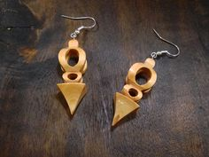 """First place winner of the second Scroll Saw & Woodworking 2016 People's Choice Contest: Jewelry! Ronald Nelson of Tierp, Sweden, made these earrings, 11/64"""" long, from hand-milled maple and finished them with clear lacquer. Inspired by Christmas decorations, Ronald said, """"I created the design in Photoshop and spent quite some time getting it to fit on the wood that I had as it is quite small."""""""