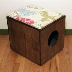 litterbox cover disguised as seating  OR thrift an inexpensive cabinet/shelf, take out the bottom drawer, place litter box inside, tack up a lil curtain.
