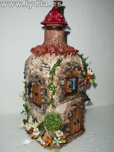 botella decorada con pasta de papel