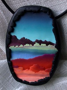 "Polymer clay picture pendant painting  called ""Paisaje con lago"" by Silvia Ortiz de la Torre aka Madreselva61, via Flickr"