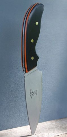 A blade for all you Harley Davidson riders. Black and orange laminated Corian scales on a stainless blade