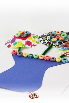 Froot Loops DIY Bouquet.  Cupcake liners make pretty flower outlines. Froot Loops cereal pieces make them even better. Have your little ones make a bouquet for grandma and/or grandpa. \
