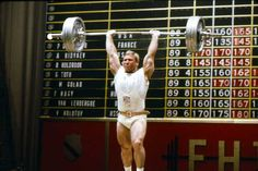A photo of an Olympic weightlifter completing the powerclean sequence with a heavy overhead press. An article I wrote about healthy digestive system and sports performance.