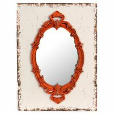Weathered wood wall mirror with a blood orange Baroque-inspired frame.