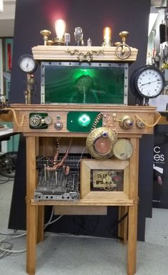 "Oshkosh Public Museum (WI) ""Uncle Irvin"" progress photo - The Steampunk Empire exhibit. The green tank holds a ""brain""; as you flip the switches on top of the table, the ""brain"" says different things with each switch."
