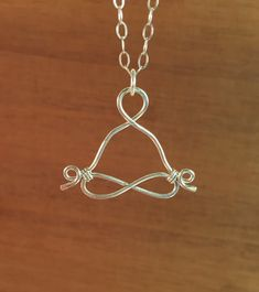 Hey, I found this really awesome Etsy listing at https://www.etsy.com/listing/219776903/sterling-silver-yogi-yoga-pose-wire