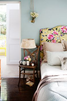 Cover a bedhead in a vibrant and floral fabric that can be easily changed for different moods or seasons.