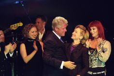 Chelsea and Cher applaud as President Clinton embraces the First Lady for her birthday celebration.  New York City. October, 2000. Happy birthday Hillary Rodham Clinton! -from the Clinton Library