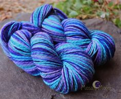 Cornish Pixie, a mix of purples and blues with aqua and teal--on Licorice Twist, worsted. http://www.mosaicmoon.com/item_269/Cornish-Pixie-Licorice-Twist-Worsted-4-oz-skeins.htm