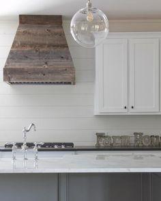 Our kitchen on HGTV.com Shiplap backsplash, west elm globe lights, barn wood ovenhood, carrera marble